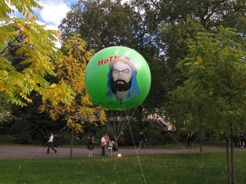 Monobrow Manifesto, PVC, print, helium, 300cm Ø, 2011. Frieze Sculpture Park, London.