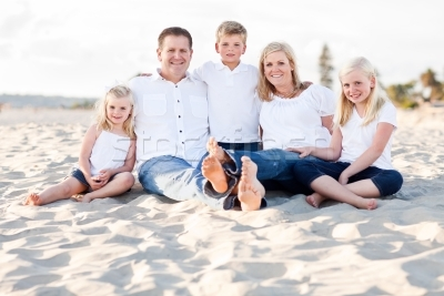 600557_stock-photo-happy-caucasian-family-portrait-at-the-beach