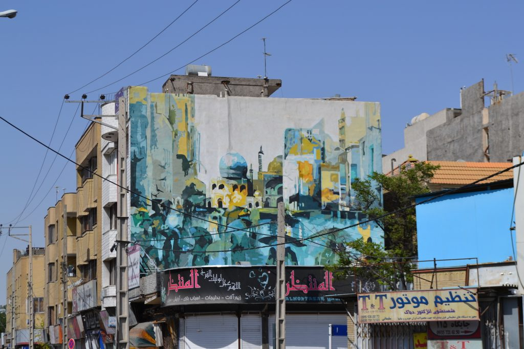 A mural painted in a water-color style depicting Islamicate architecture of Mashhad.