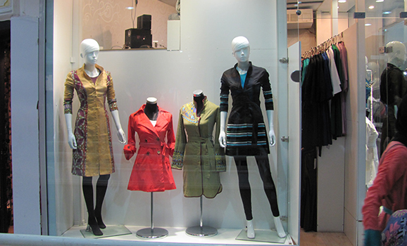 A boutique showcasing trendy manteau, or the long coat typically worn by some Iranian women.