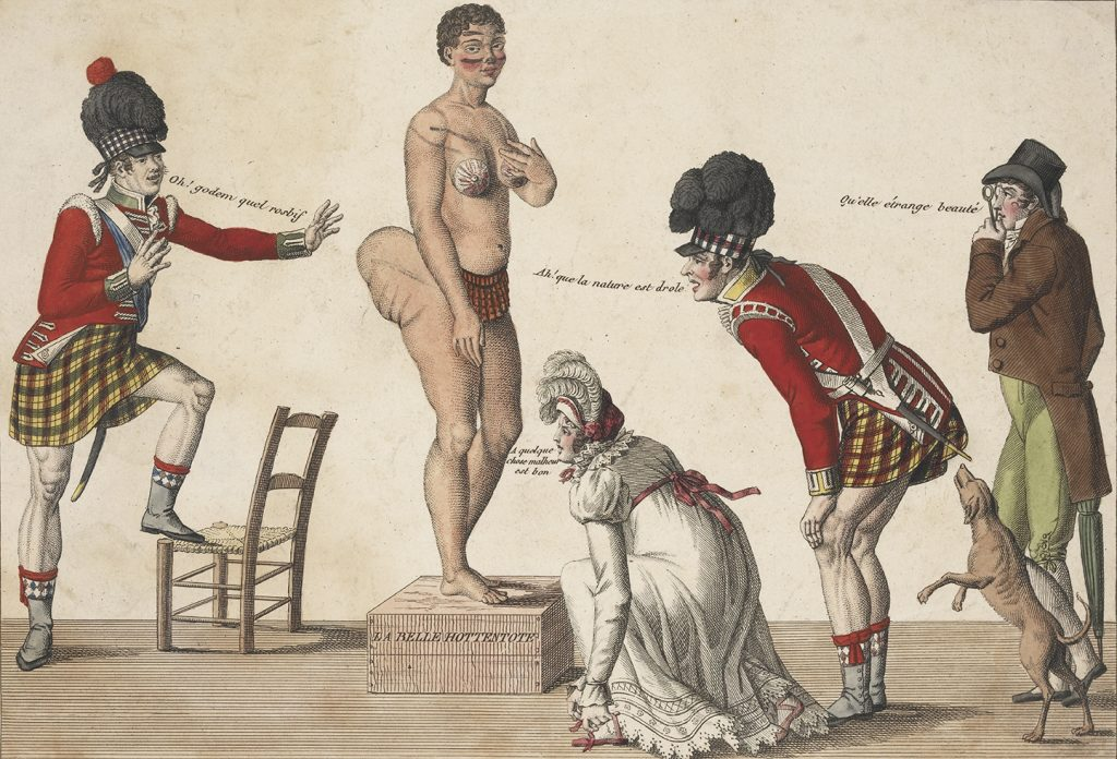 """Frenchmen surround Saartjie Baartman, with comments like """"what strange beauty"""" and """"oh! how funny is nature"""" as they examine her body at an exhibit."""