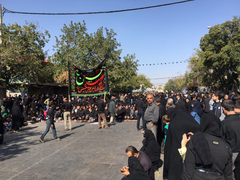 Ashura processions in the streets are paused for noon prayers in Qazvin