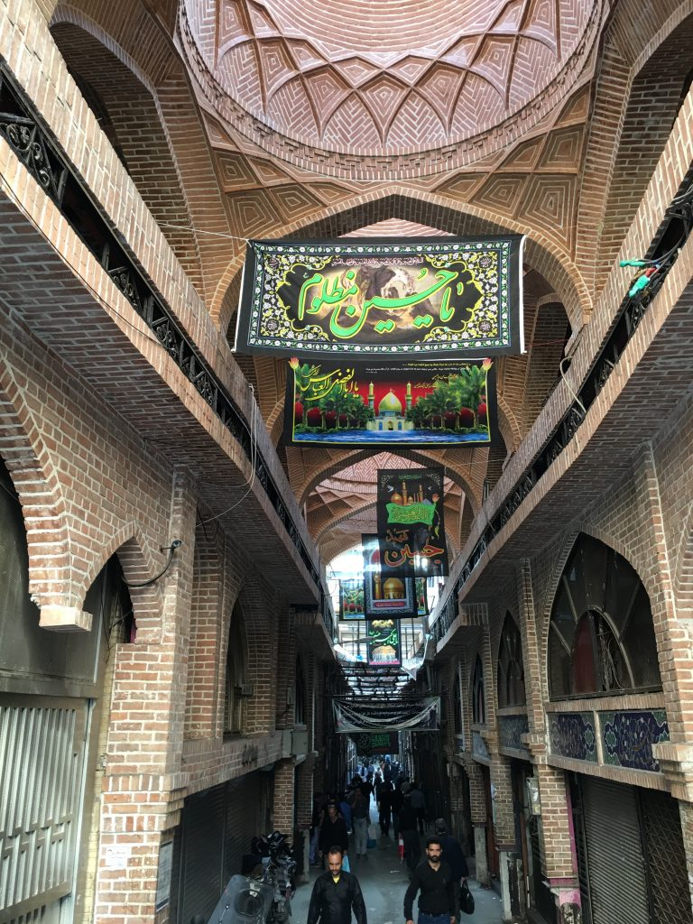 "Tehran's Grand Bazaar, like many other places in Iran, will be decorated with black flags remembering Husayn until Arbaeen, or the ""the 40t,"" when the mourning period comes to an end."