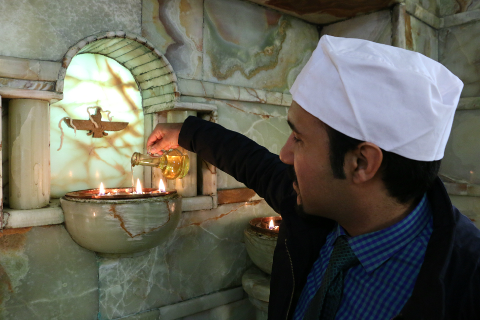 Pouring oil into the fire is part of the customs of worship at the Shah Varharam Izad Temple.